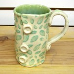 Buttoned Up Cup by Lindsay Philabaun